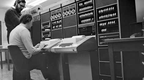 Ken Thompson and Dennis Ritchie, overlook the PDP-11.